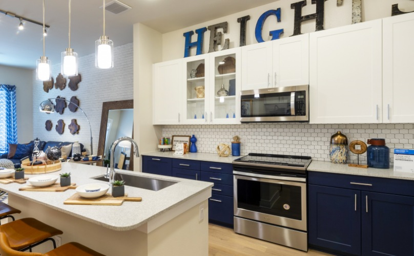 Apartment home kitchen with Heights sign