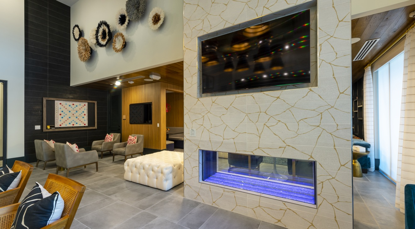 Beautiful tiled fireplace with plush seating and games