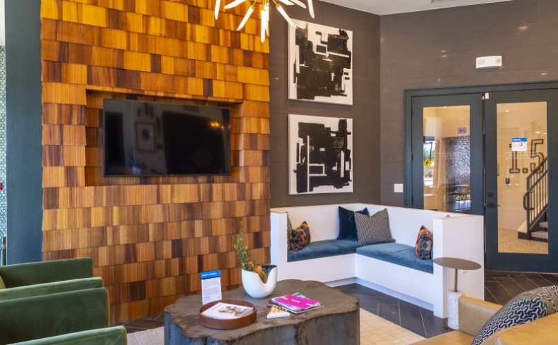 Leasing Center lounge area with wooden wall